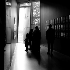 Silhouetted family views exhibit in African American History Museum DC