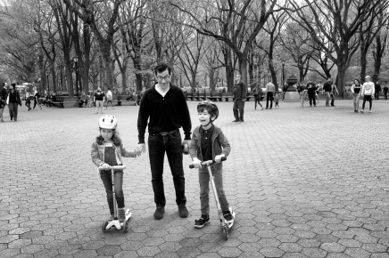 Dad with children on scooters NYC Central Park