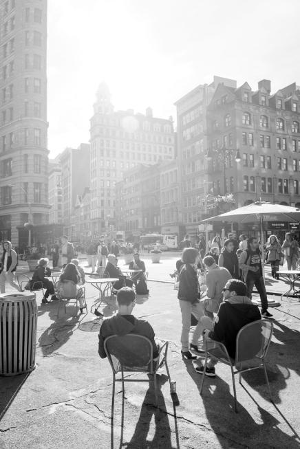 People enjoying sunny day NYC Flatiron Plaza