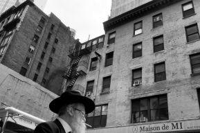 Smoking man in hat NYC