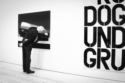 Man studies artwork NYC Whitney Museum