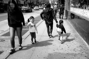children lag behind parents while walking the streets