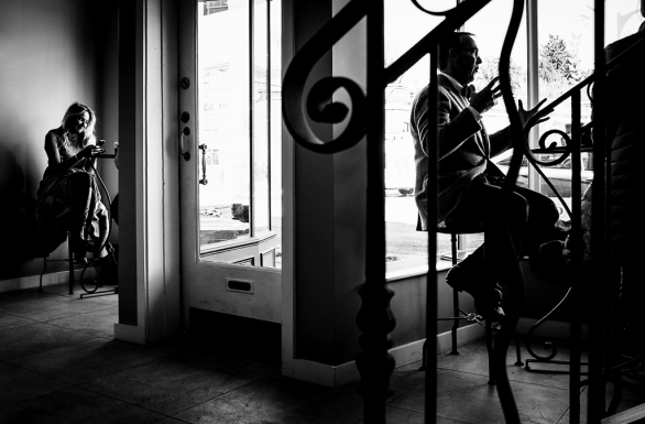 Silhouettes of customers in a cafe