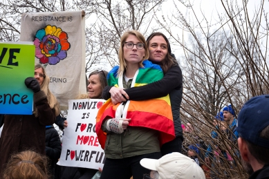 Couple wrapped in Pride Flag Women's March DC